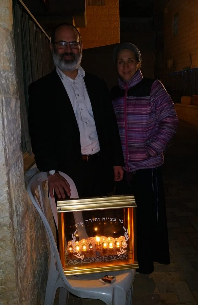 Rav Shalom Miller and Batya Miller celebrating Chanukah in the Old City of Jerusalem